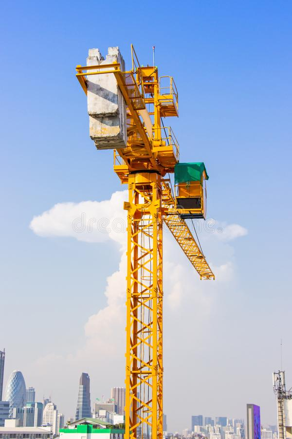 Crane is used in the construction of high buildings for tool of large industry under the blue sky and white clouds.  stock photography