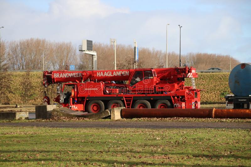 Crane vehicle of the fire brigade Haaglanden with reach of 51 meters to save people or rerail a tram in The Hague. Crane vehicle of the fire brigade Haaglanden royalty free stock images