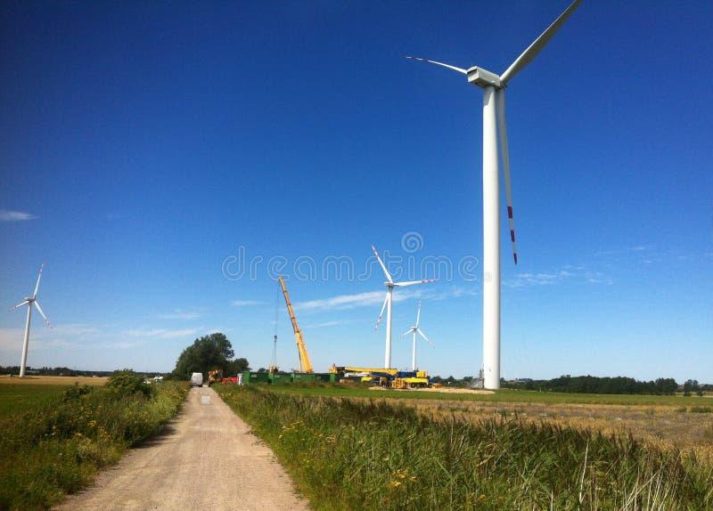 Crane at windmill farm royalty free stock photo