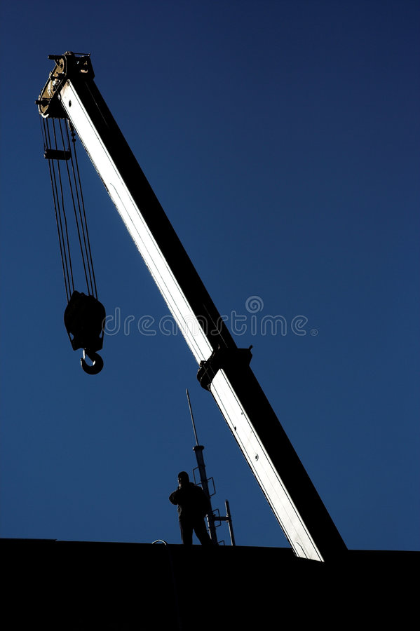 Crane And Worker Stock Images