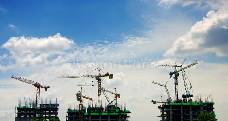 Crane and workers at construction site.  stock photo