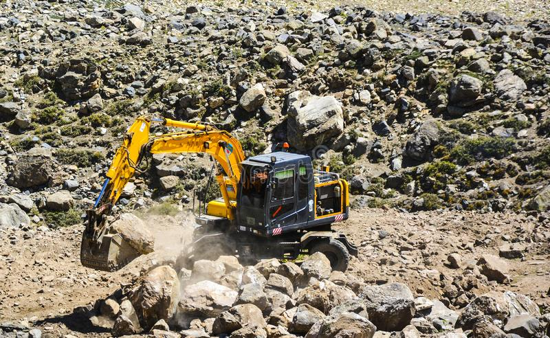 Crane working in a hillside. Somewhere in Lulusar. Lulusar is group of mountain peaks and a lake in the Kaghan Valley in the Khyber-Pakhtunkhwa province of royalty free stock image