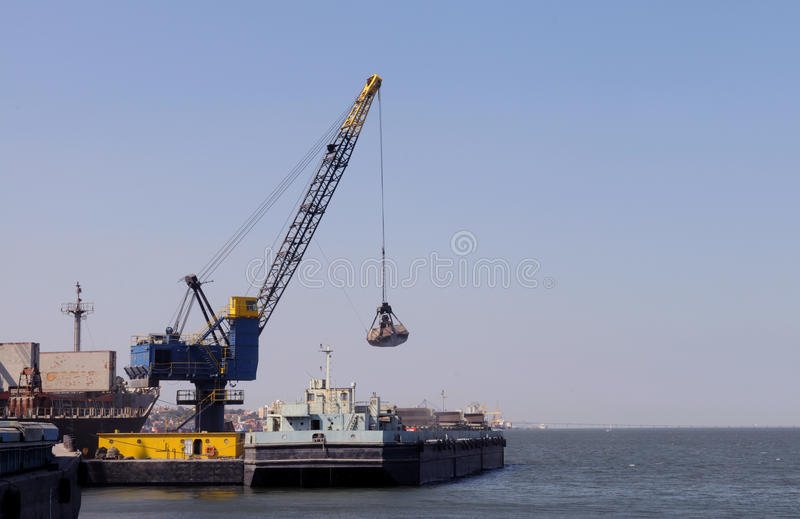 Download Crane Working On A Platform In The River Stock Photo - Image: 24797180
