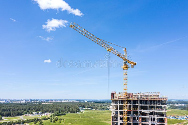 Crane working on under construction highrise residential building stock photos