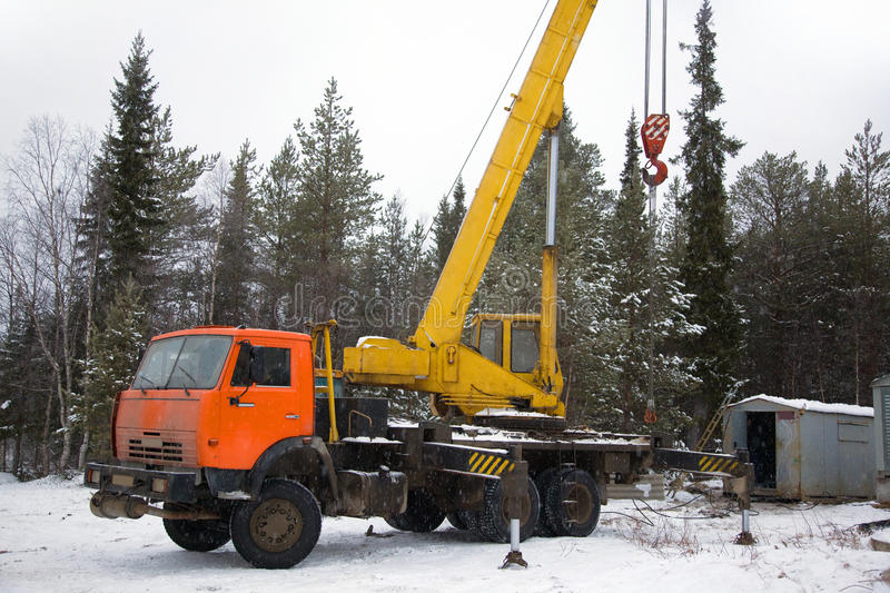 Download Crane Working In The Woods In Winter Stock Photo - Image of taiga, mover: 22148874