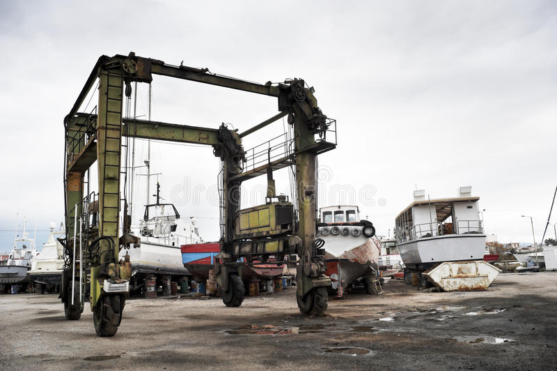 Crane for yacht maintenance royalty free stock image