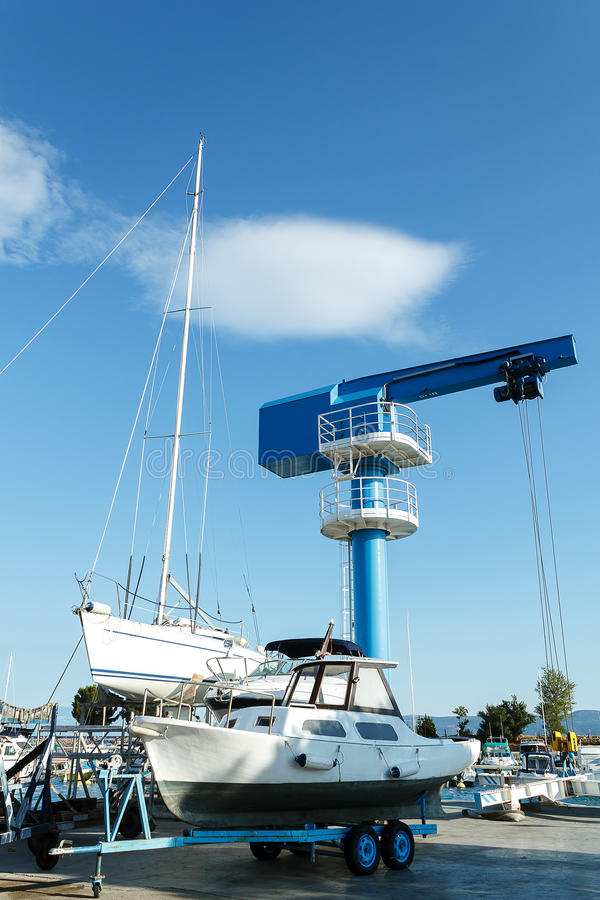 Crane in yachts service and shipyard in port. Croatia royalty free stock photography