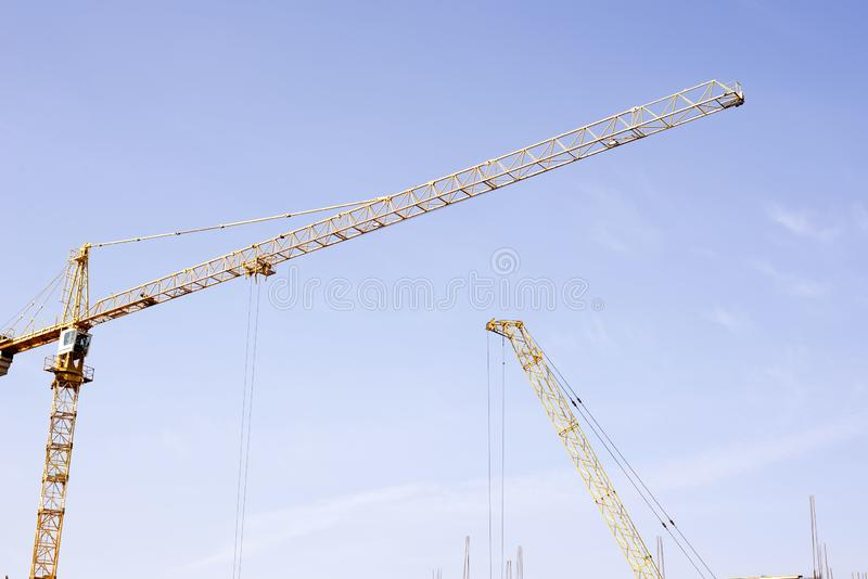 Cranes on the background of the sky royalty free stock photography