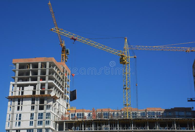 Cranes construction. Building construction growth and global construction industry concept. Photo royalty free stock photo