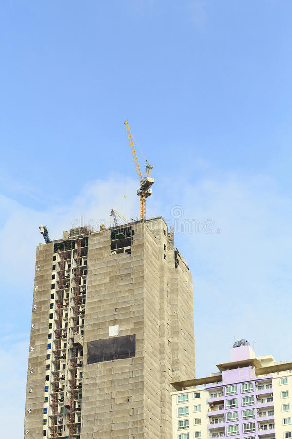 Cranes in construction site with blue sky. royalty free stock photo