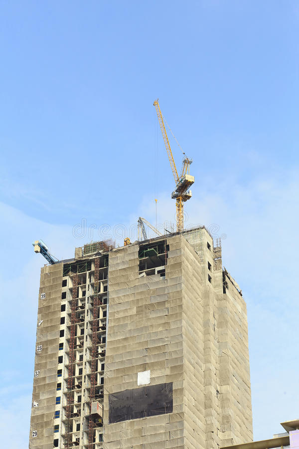 Cranes in construction site with blue sky. royalty free stock photography
