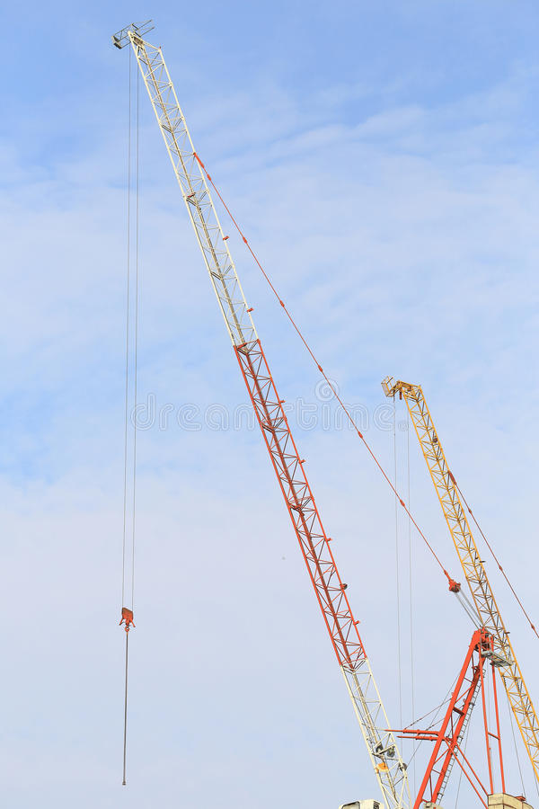 Cranes in construction site with blue sky and cloud. stock photo