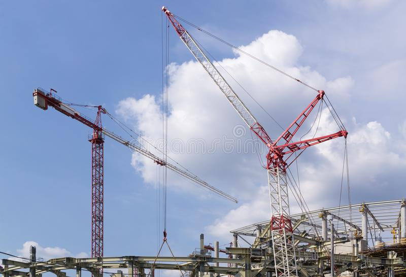 Cranes on construction site royalty free stock image