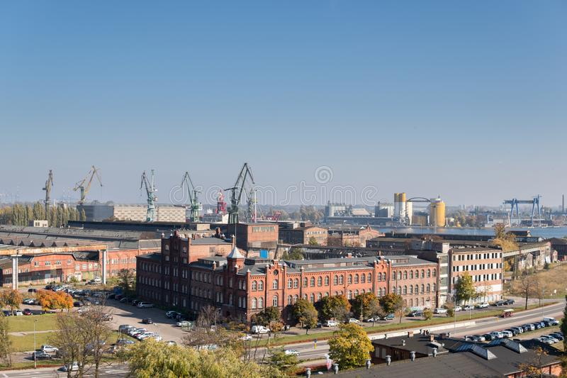 Cranes in gdansk shipyard. October, 2018, Gdansk, Poland: city landscape with former building of gdansk shipyard, Historical place of Polish workers strike in royalty free stock photo