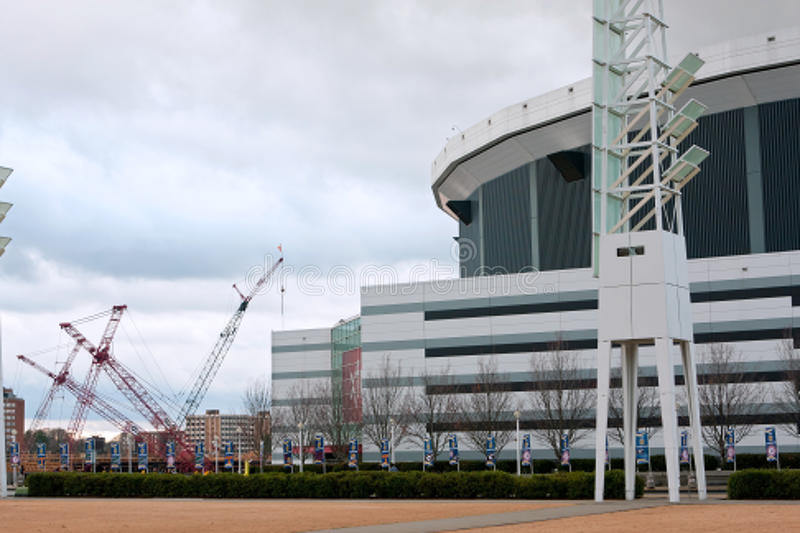 Cranes At New Stadium Site Sit Next To Georgia Dome royalty free stock image