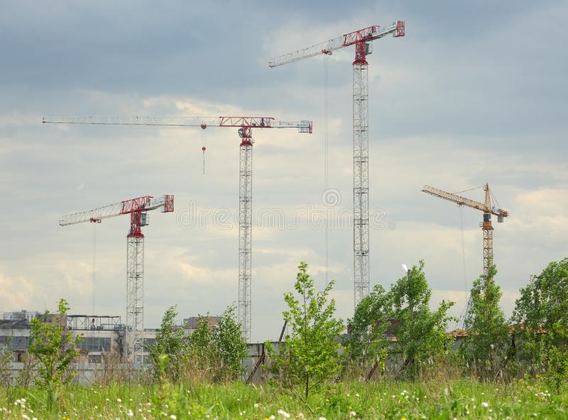 Cranes on the outskirts of the city. A cranes on the outskirts of the city stock photo