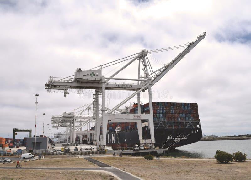 Cranes at Port of Oakland shipping yard stock photo