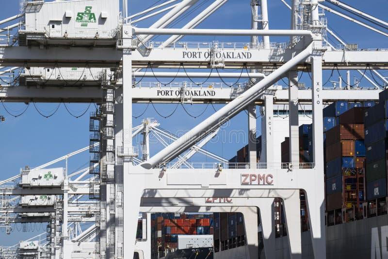 Cranes at Port of Oakland shipping yard royalty free stock image
