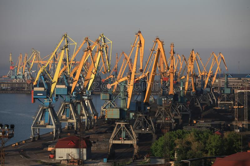 Cranes in the sea port of the Azov Sea. Industrial seaport royalty free stock images
