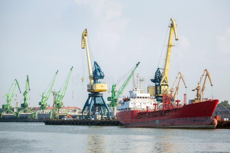 Cranes and ship in Klaipeda harbor stock photo