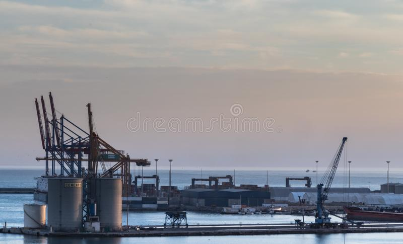 Cranes in a shipyard in the port of Malaga, Spain stock image