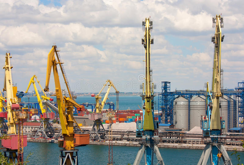 Cranes, tanks and containers in marine cargo port. stock photos