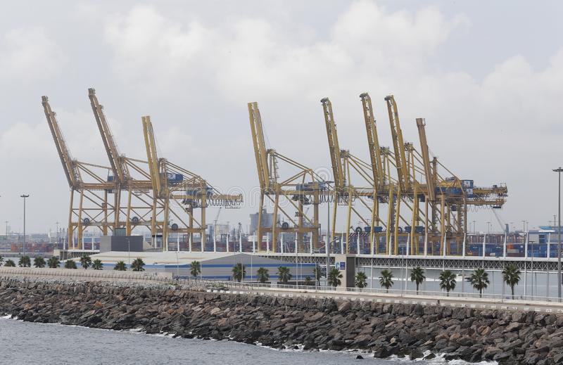 Cranes to load and unload cargo freighters in barcelona port stock photography