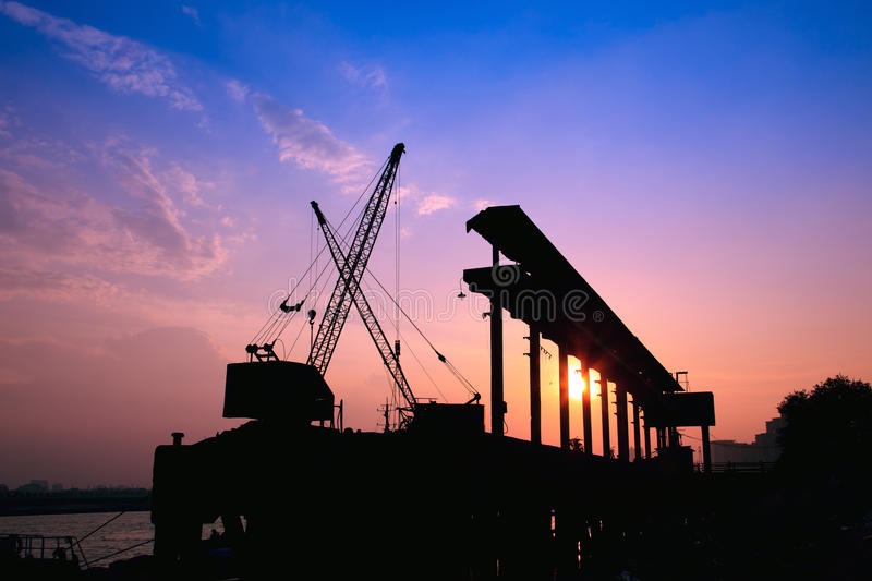 Download Cranes working at sunset stock image. Image of construction - 20579213