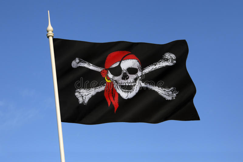 Cranio e bandiera di tibie incrociate - Jolly Roger fotografia stock libera da diritti