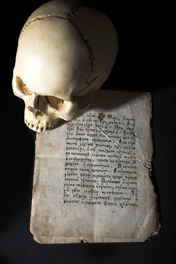 Cranium and old manuscript stock image