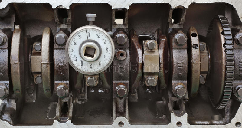 Crankshaft with angle measuring tool stock photography