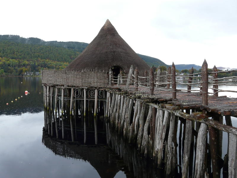 A Crannog on Loch Tay. A reconstruction of a bronze age settlement known as a Crannog on Loch Tay in Scotland royalty free stock image