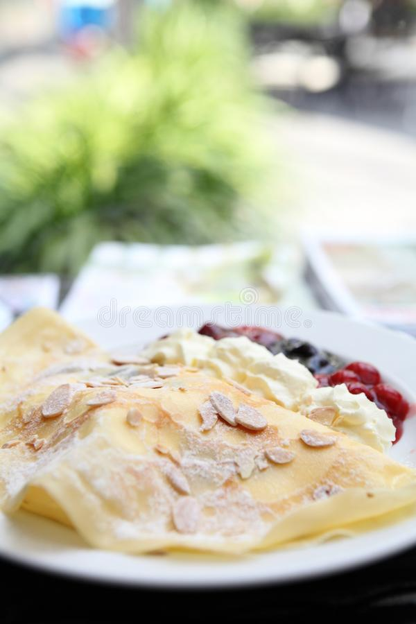 Crepe cake with berry sauce. On a plate stock image