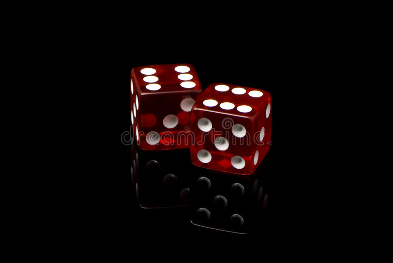 Craps. On a black background royalty free stock photography