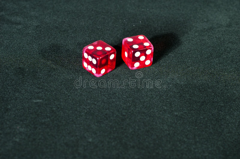 Craps Dice - Seven. 2 Dice showing seven, one with a 4 and one with a 3 stock photos