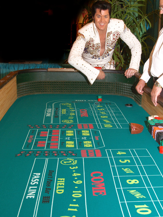 Craps With Elvis 4. The King, Elvis Presley impersonator playing craps in Las Vegas stock photos