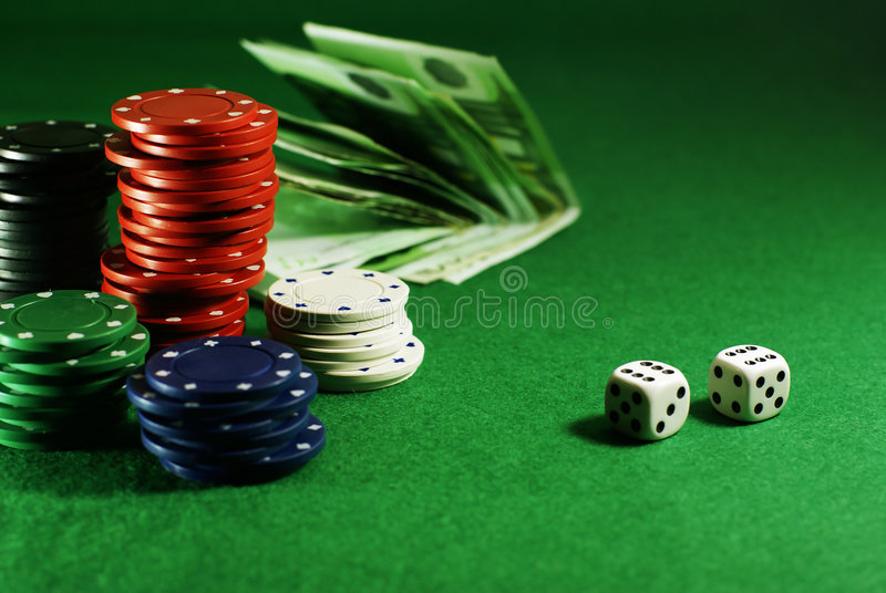 Craps on the green table. With dibs and money stock photography