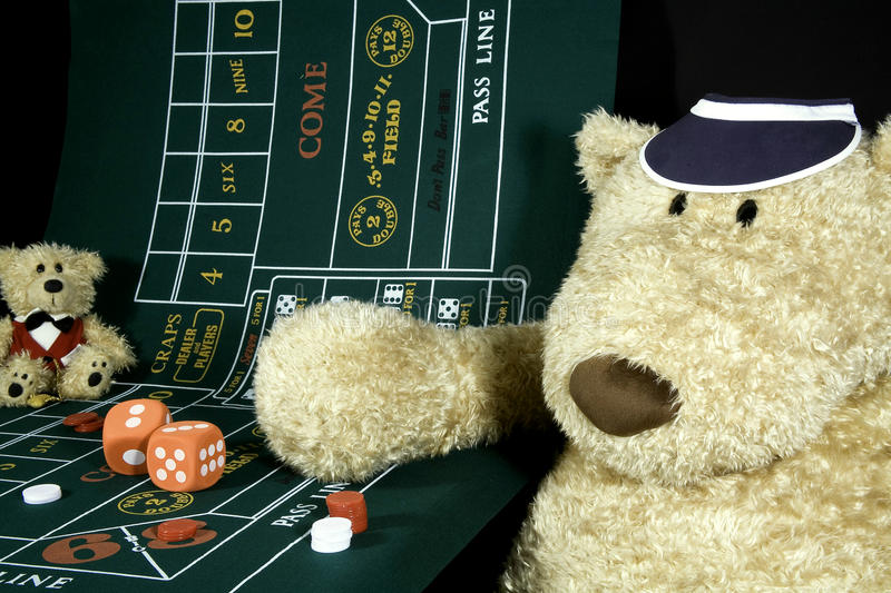 Craps Player. Oversized teddy bear at the craps table stock photos
