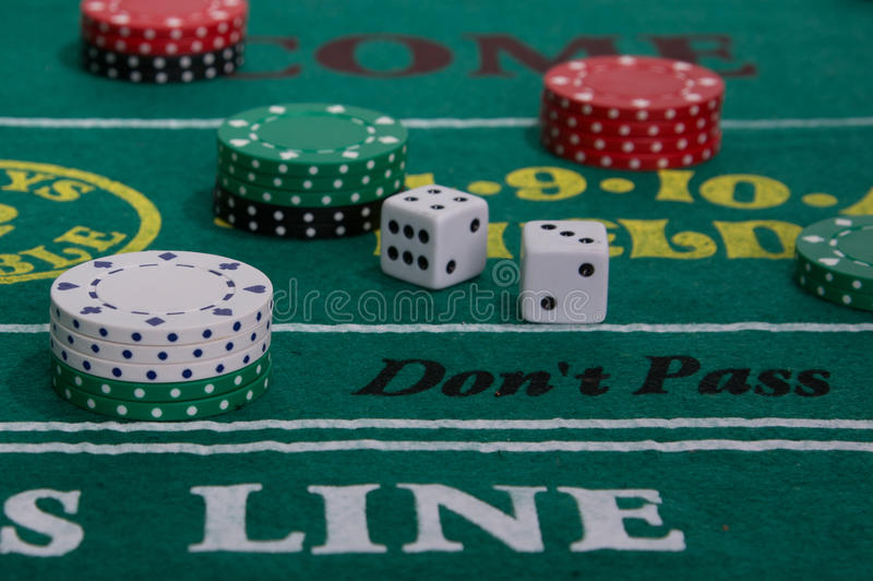 Craps Table. With casino chips and dice stock photo