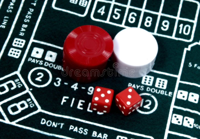 Craps Table. Photo of a Craps Table With Dice and Chips. Slight Color and Blur Effect stock photo