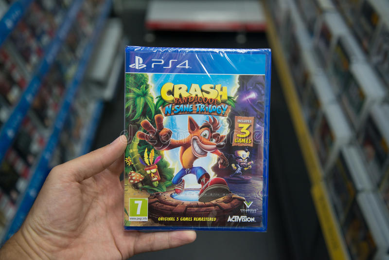Crash Bandicoot N Sane Trilogy. Bratislava, Slovakia, june 30, 2017: Man holding Crash Bandicoot N Sane Trilogy videogame on Sony Playstation 4 console in game royalty free stock photography