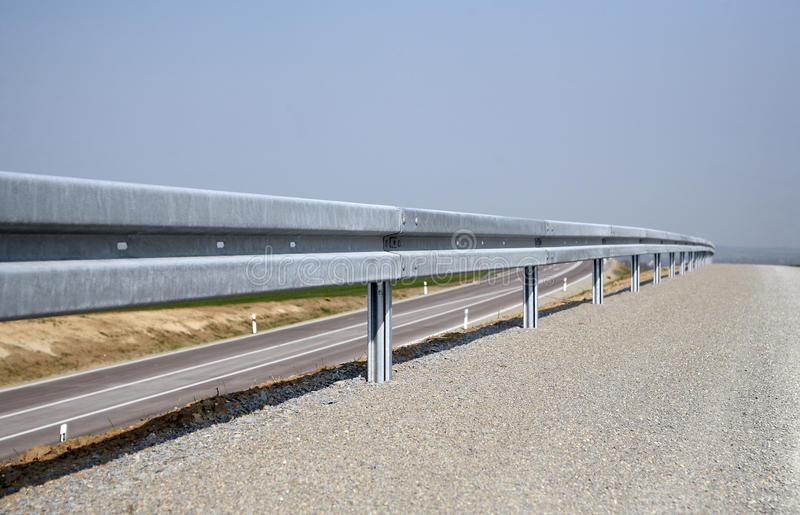 Crash Barrier And Road Stock Photos