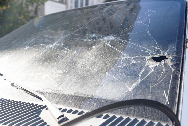 Crash when colliding the windshield of a car. Broken car windshield, crash when colliding the windshield of a car royalty free stock image