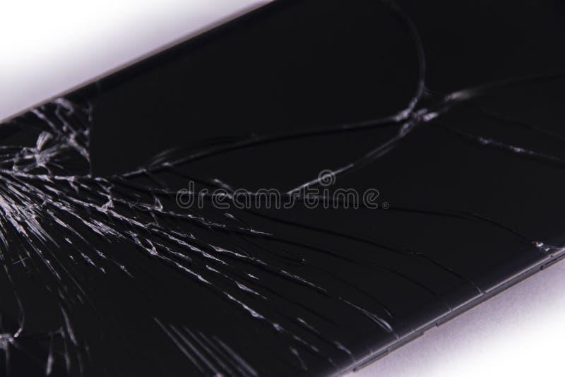 Crash-Glas schwarzer Hintergrund Smartphone abgebrochen stockfotos