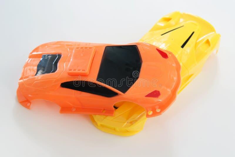 A crash scene of plastic car toys. A crash scene of plastic car body toys stock photos