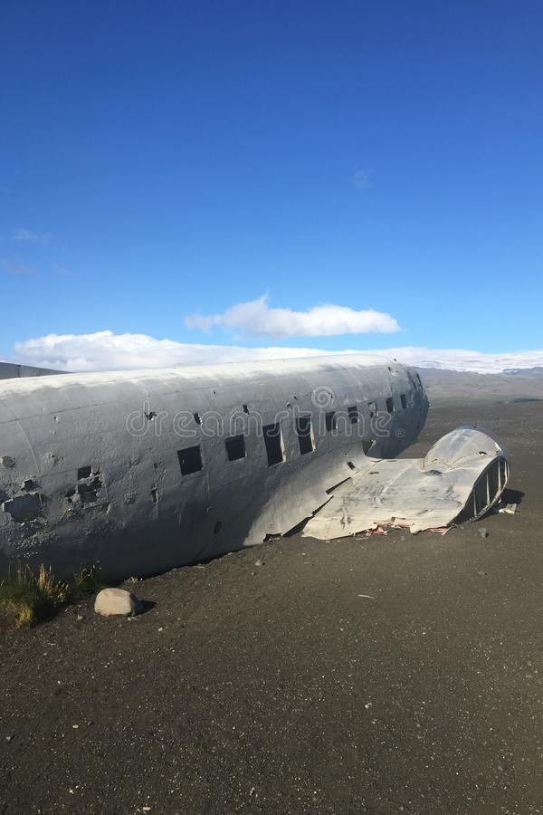 A crashed abandoned airplane in a field stock images