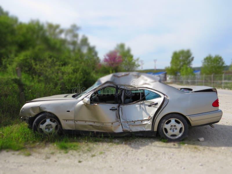 Crashed car. Smashed sheet metal grey bodywork. Danger on the road. Mortal driving royalty free stock images