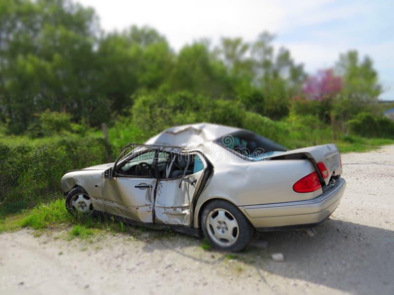 Crashed car. Smashed sheet metal grey bodywork. Danger on the road. Mortal driving stock image