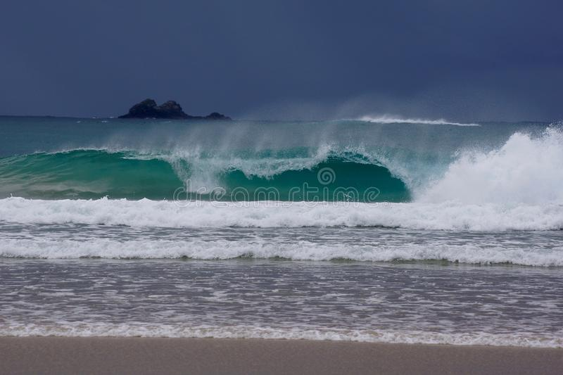 Crashing, rolling waves. Rolling in and crashing tropical waves onto beach royalty free stock images