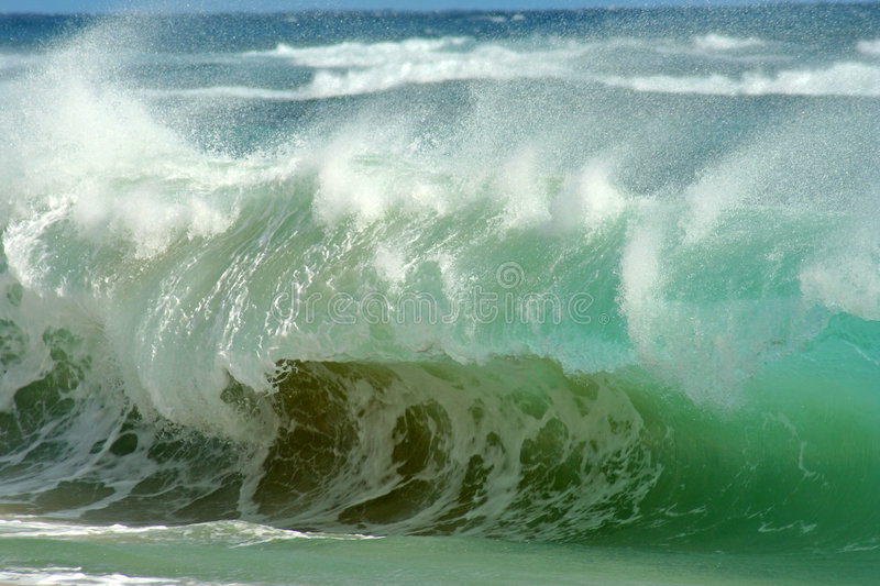 Crashing waves. Photograph of a barreling wave crashing on the sand at Sandy Beach on the South Shore of Oahu, Hawaii royalty free stock images